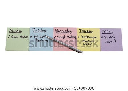Horizontal photo of multiple color stickers, displaying things to do on each separate color, with silver pen on isolated white background