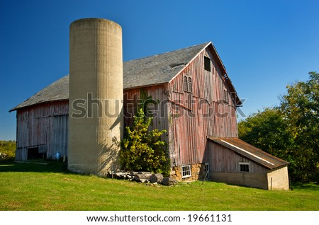 Horizontal photo of old red barn with silo in rural Virginia