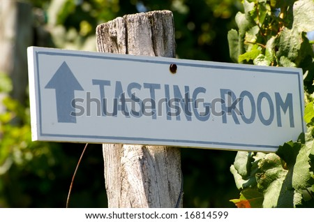 Horizontal photo of sign in vineyard pointing direction