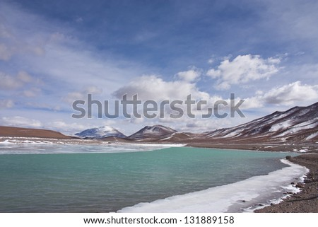 Horizontal photography of the icy shore of the Lake on Route 27, Paso Jama, on the way to Salar de Tara - Atacama Desert - Chile