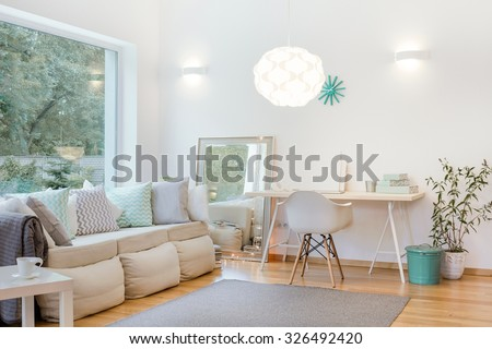 Horizontal picture of bright living room arrangement