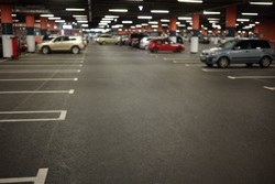 Horizontal picture of car parking or underground garage interior with neon lights and autocars parked. Buildings, urban constructions, space, transportation, vehicle and night city concept