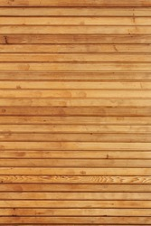 Horizontal pine wooden panels used for background.