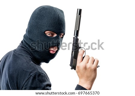 Horizontal portrait of a terrorist with a gun with a silencer on a white background #697665370