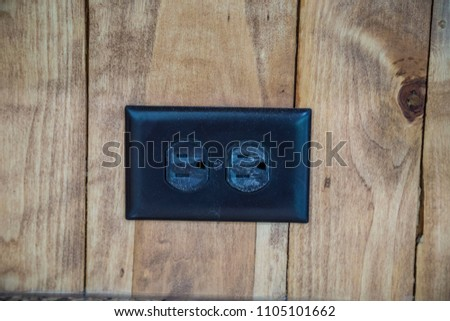 Horizontal power outlets plug in wood background three prong close up power electricity