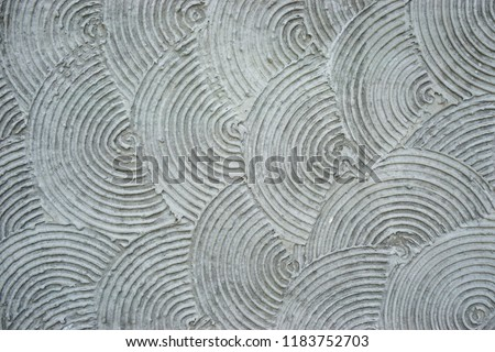 Horizontal repeating swirl pattern with concentric circular grooves abstract background