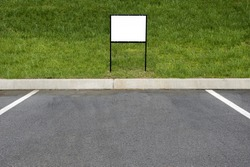 Horizontal Shot Of A Blank Sign In Front Of Parking Place