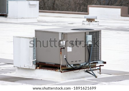 Horizontal shot of a commercial rooftop air conditioning unit. Stock photo ©