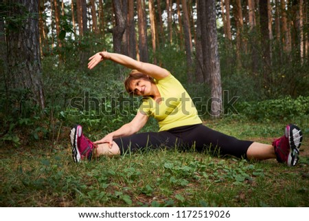 Horizontal shot of a happy senior woman exercising outdoors on a nice summer day. Active mature lifestyle. Lifestyle concept #1172519026
