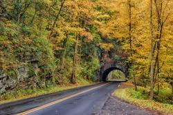 Horizontal shot of Autumn Color Surrounding a Smoky Mountain Tunnel