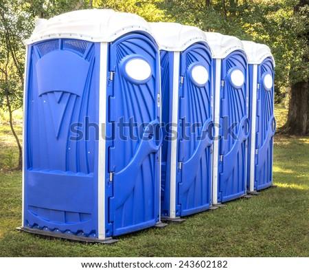 Horizontal Shot Of Blue Port Potties Or Portable Toilets #243602182