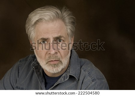 Horizontal Shot Of Man Showing Fear Or Anxiety/ Fear And Anxiety