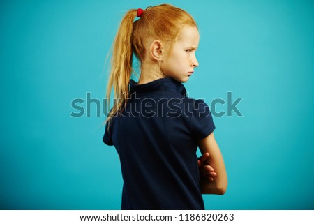Horizontal shot of offended child, turned away from camera, stands with his back, turns around and gets angry. Malicious girl with bad mood has difficult character. #1186820263