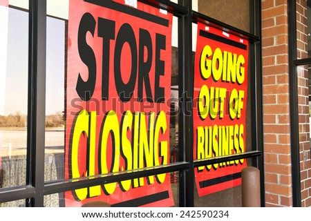 Horizontal Shot Of Signs Of The Recession/ Going Out Of Business