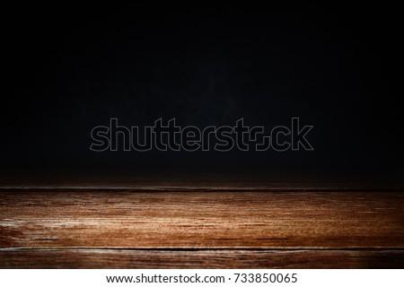 Horizontal shot of the elegant brown wooden texture on dark background