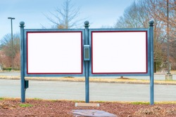Horizontal shot of two blank twin outdoor signs or bulletin boards.  Lots of copy space.