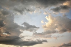 Horizontal soft focus image of beautiful grey clouds with blue sky and little birds for nature or abstract background concept.
