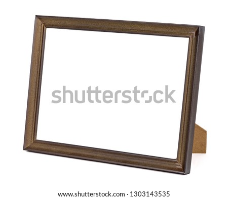 Horizontal standing brown wooden picture frame isolated on white background with clipping path
