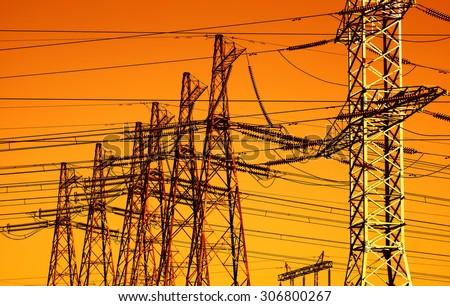Horizontal vibrant evening orange sunset power lines background