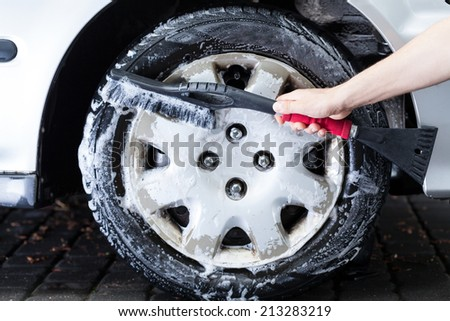 Horizontal view of a professional hubcap cleaning #213283219