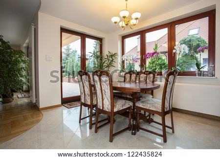 Horizontal view of a spacious dining room
