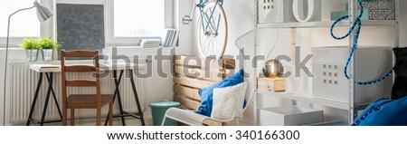 Horizontal view of bright studio flat interior