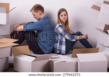 Horizontal view of couple arguing during relocation