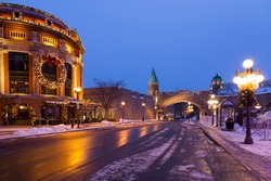 Horizontal view of the 1939 Saint John Gate seen in the old town during a winter blue hour morning, Quebec City, Quebec, Canada
