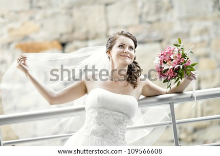 horizontal wedding portrait beautifull  fiancee with  bouquet  in white dress, soft light