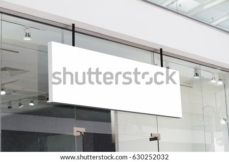 horizontal white empty signage on clothes shop front with glass windows