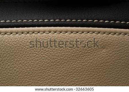 horizontally seam black and creamy leather
