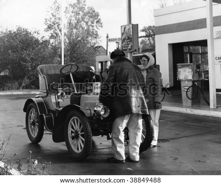 HORLEY, ENGLAND-NOVEMBER 6: A  car stops at a garage during the London-Brighton Veteran Car Run on November 6, 1977 in Horley, Surrey. The 86k run is the worlds longest running motoring event.