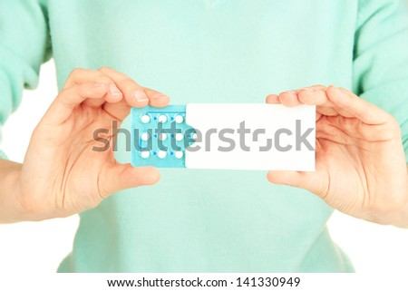 Hormonal pills in female  hands isolated on white