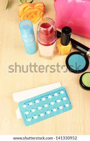 Hormonal pills in women's bedside table close-up