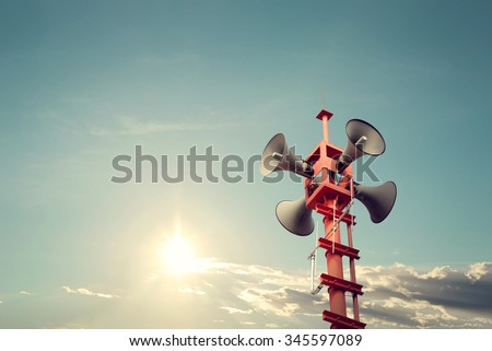 Photo of  Horn speaker for public relations sign symbol, vintage color - sun with blue sky