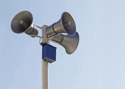 Horn speaker on top of pole