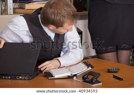 horny businessman looking at woman legs in a office