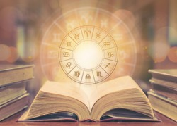 Horoscope astrology, Zodiac sign and constellation study for foretell and fortune telling education course concept with horoscopic wheel over old book in school library