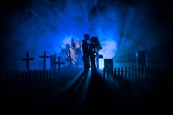 Horror Halloween concept. Scary zombie bride on a night cemetery. Selective focus