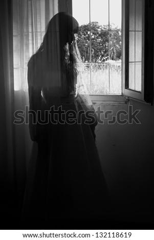 Horror Scene of a Creepy Woman in the Wedding Dress - stock photo