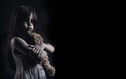 Horror Scene of a Possessed children girl black long hair hug doll ghost halloween in dark room