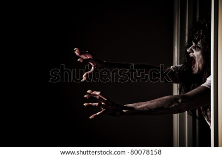 Horror Scene of a Woman Possessed Grabbing out of Doorway