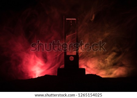 Horror view of Guillotine. Close-up of a guillotine on a dark foggy background. Execution concept #1265154025