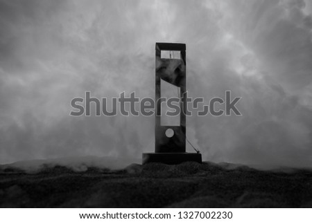 Horror view of Guillotine. Close-up of a guillotine on a dark foggy background. Execution concept #1327002230