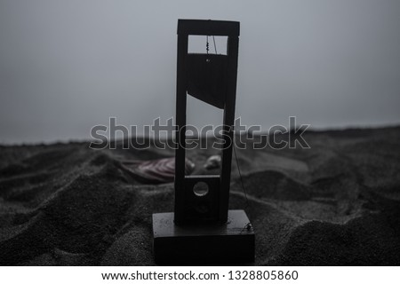 Horror view of Guillotine. Close-up of a guillotine on a dark foggy background. Execution concept #1328805860