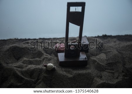 Horror view of Guillotine. Close-up of a guillotine on a dark foggy background. Execution concept #1375540628