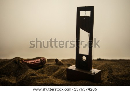 Horror view of Guillotine. Close-up of a guillotine on a dark foggy background. Execution concept #1376374286
