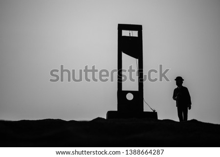Horror view of Guillotine. Close-up of a guillotine on a dark foggy background. Execution concept #1388664287