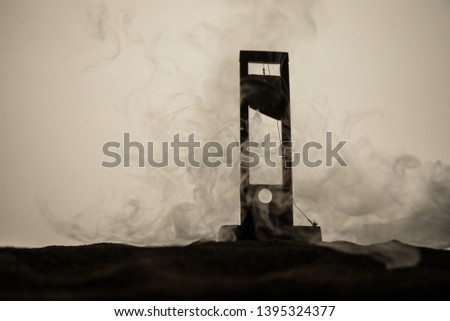 Horror view of Guillotine. Close-up of a guillotine on a dark foggy background. Execution concept #1395324377