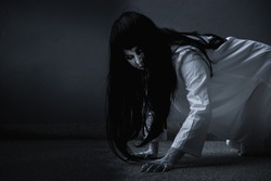 Horror woman ghost creepy crawling, Female in white dressed scary costume, Halloween festival day concept